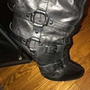 Worn boots leather black